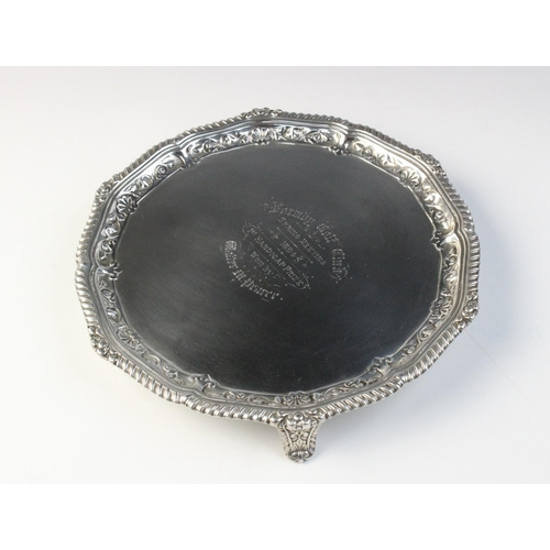 7 - GOLFING INTEREST: A Victorian silver salver by Josiah Williams & Co, London 1893, with reeded and em...