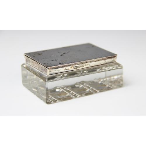 21 - An Edwardian cut glass silver mounted stamp box by Levi & Salaman, Birmingham 1905, of rectangular f...