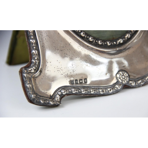 22 - An Edwardian silver mounted photograph frame by Charles S Green & Co Ltd, Birmingham 1906, of shaped...