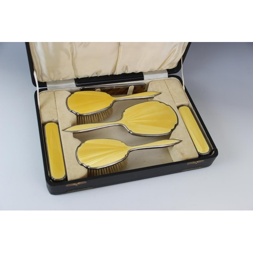 24 - An Art Deco silver mounted and enamelled dressing table set by Beddoes & Co, Birmingham 1935-36, com...