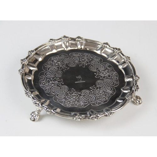 28 - A George III Irish silver waiter, possibly by Thomas Townsend, of circular form with scalloped borde...