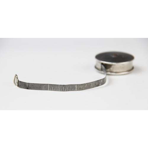 33 - A George V silver cased tape measure by Crisford & Norris, Birmingham 1914, of circular plain polish...