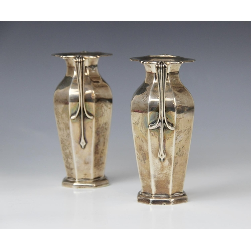 35 - A pair of Edwardian silver twin-handled vases by Goldsmiths & Silversmiths Company, London 1909, eac...