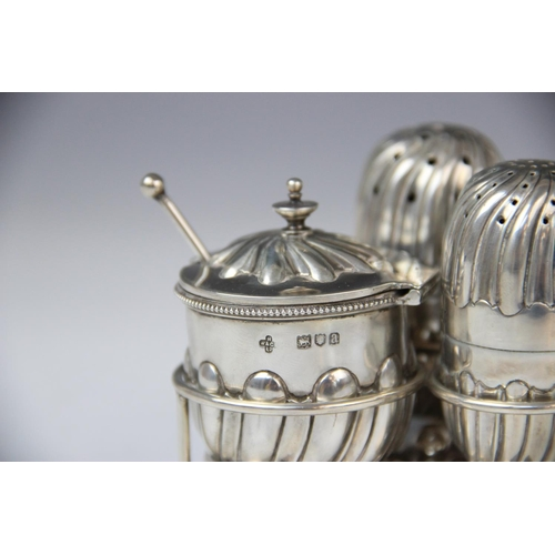 37 - A Victorian silver condiment set on stand by Horace Woodward & Co Ltd, London 1896-8, comprising wet...