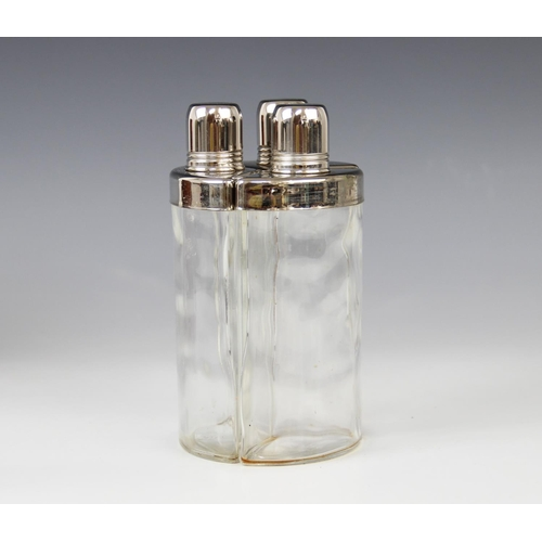 42 - A mid 20th century three-piece glass and white metal hunting flask set, each of faceted form with pl...