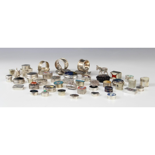 46 - A selection of pill boxes, novelty containers and table accessories, to include a continental silver...