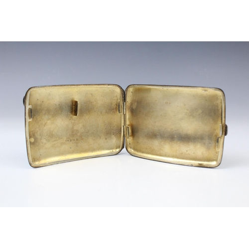 43 - A George V silver cigarette case by William Hair Haseler, Birmingham 1924, of curved rectangular for...