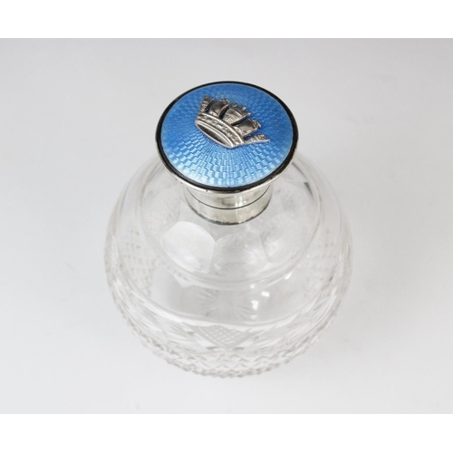 48 - A George V cut glass, silver and enamel scent bottle, marks for Finnigans Ltd, London 1925, of spher...