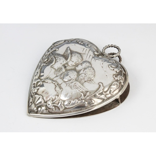 49 - A Victorian silver desk clip by William Comyns, London 1896, in the shape of a heart decorated with ...