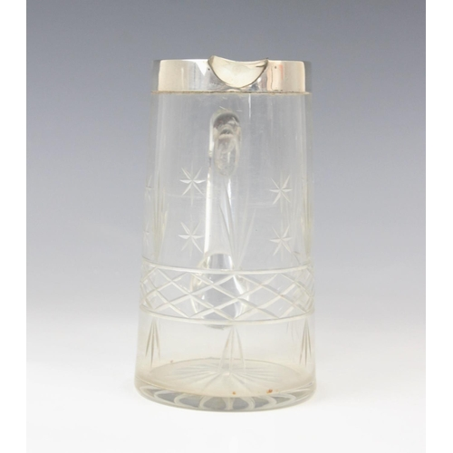 54 - A George V cut glass silver mounted jug, marks for John Grinsell & Sons, Birmingham 1924, of tapered...