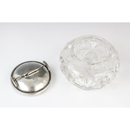 55 - A George V cut glass sugar bowl and silver cover, marks for W Coulthard Ltd, Birmingham 1931, the ci...