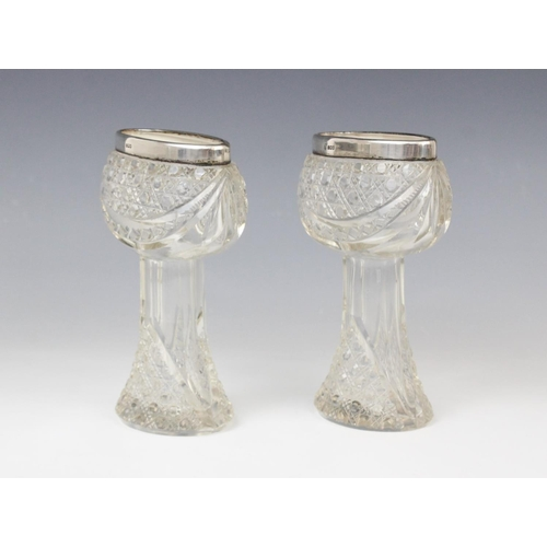 56 - A pair of George V cut glass silver mounted posy vases, marks for London 1914 (maker's marks worn), ...