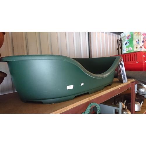 19 - Large green plastic dog bed...