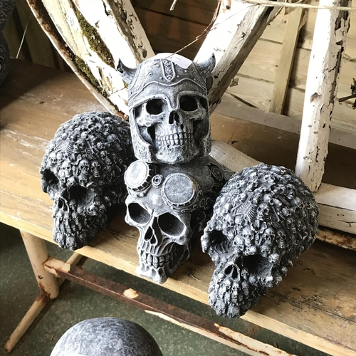 24 - Four decorative skull garden ornaments...