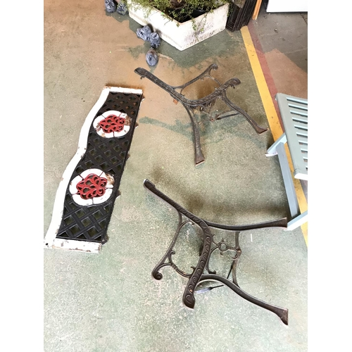 29 - Red, black & white Cast iron bench ends and back...