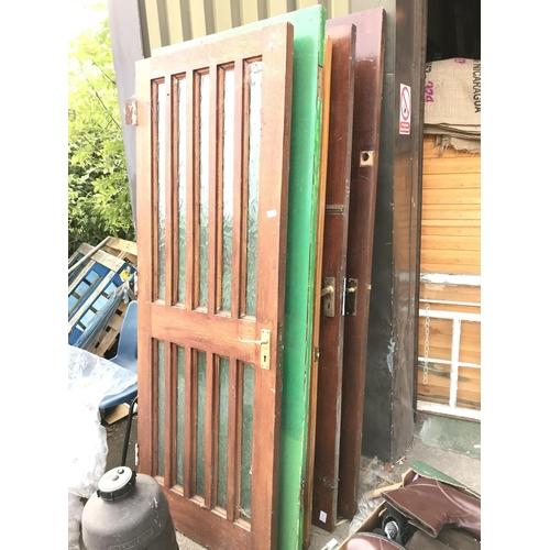 4 - A mixed lot of five hardwood standard size external doors....