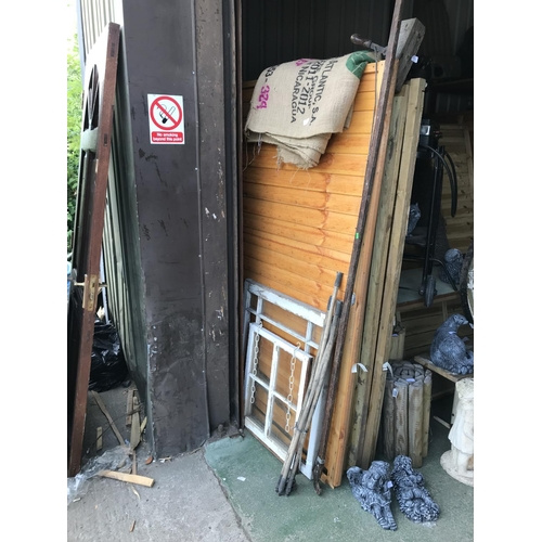 5 - A collection of vintage outdoor items, includes old drain rods, windows and tree lopper...