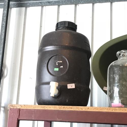 36 - Small black dispenser barrel with tap...