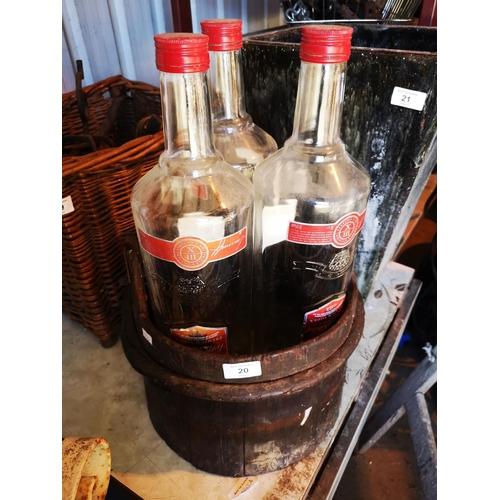 20 - Vintage wooden bucket with three large smirnoff vodka bottles...