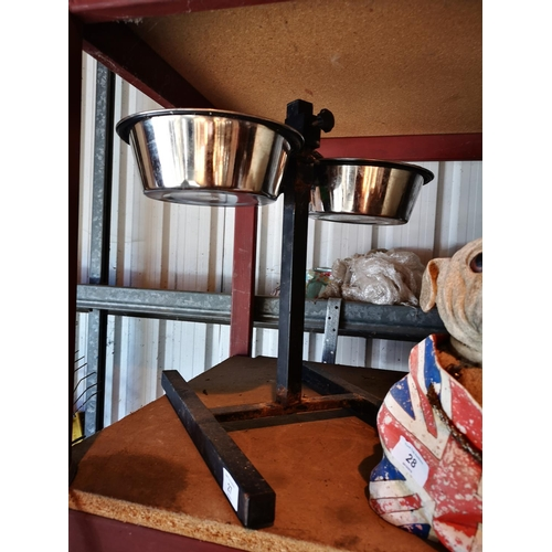 27 - Dog feeding station with two stainless steel bowls...