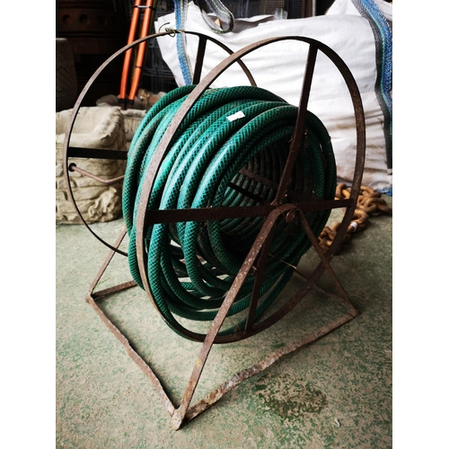 22 - Length of green hose on vintage hose reel...