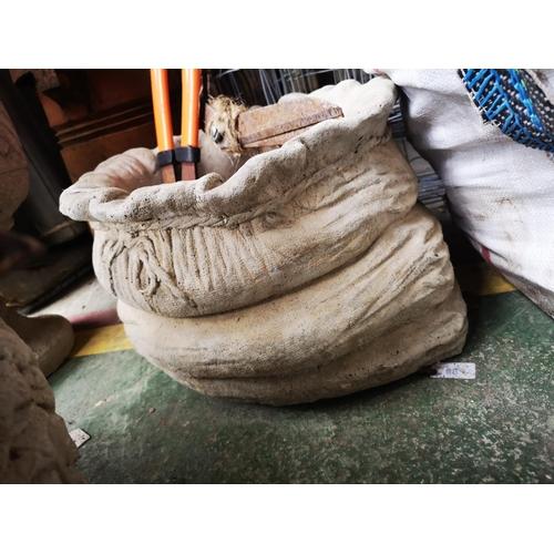 24 - Large concrete sack pattern planter...