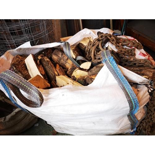 26 - Large builders tote bin of seasoned logs...