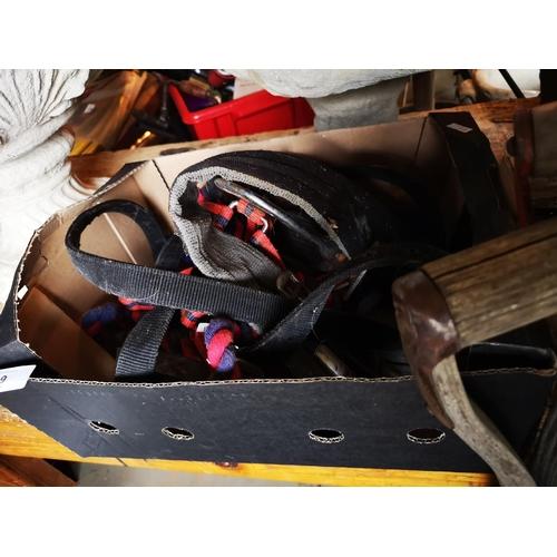 39 - Box of mixed horse tack, bridles, stirrups and girth straps...