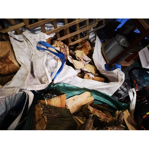 10 - Large industrial tote bag of split seasoned logs...