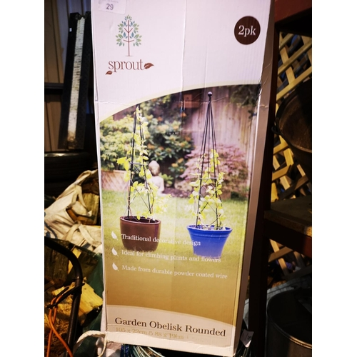 29 - Boxed  as new two small garden obelisks - 105 x 22 and 88 x 19...