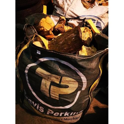 7 - Large industrial tote bag of split seasoned logs...