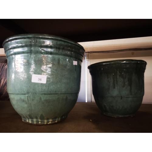 36 - Two green glazed ceramic planters...