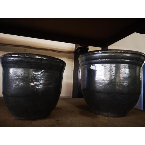 36A - Two black glazed ceramic planters...