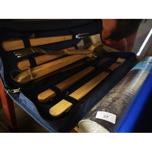 37 - BBQ tool kit in carry case plus roll of radiator reflective foil...