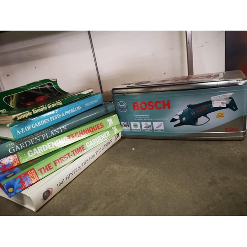 50B - Bosch cordless garden shears in good working order plus collection of gardening books...