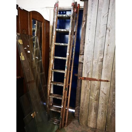 22 - Nine rung 3 stage wooden ladder...