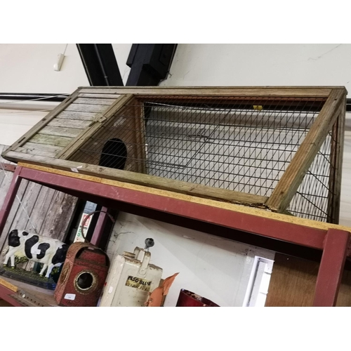 32 - Triangular wooden chicken coup and run approx 6' long...