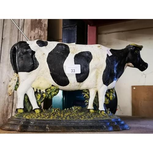 33 - Large Cast iron cow door stop...