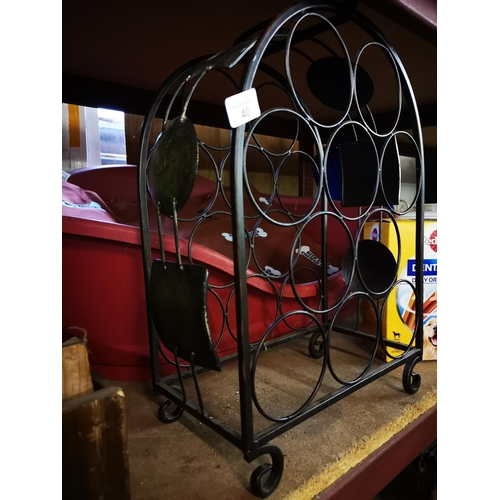 40 - Metal ten bottle wine rack...