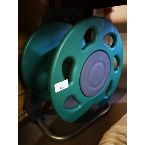 43 - Green plastic hose reel...