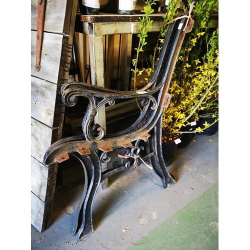 43 - Two cast iron bench ends...