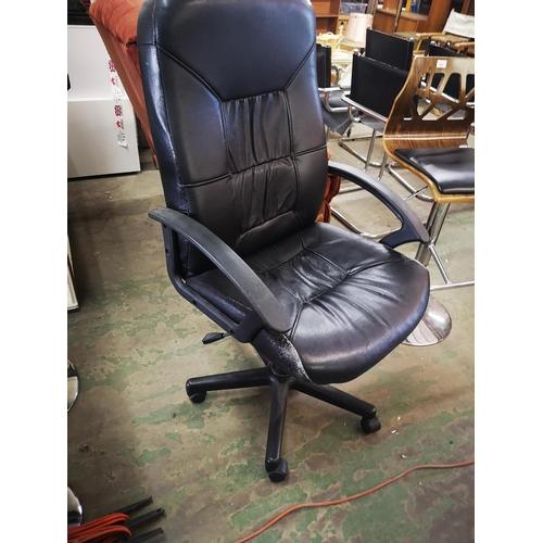 428 - Black swivel office chair...