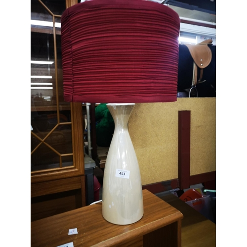 453 - Lustreware table lamp with red shade...
