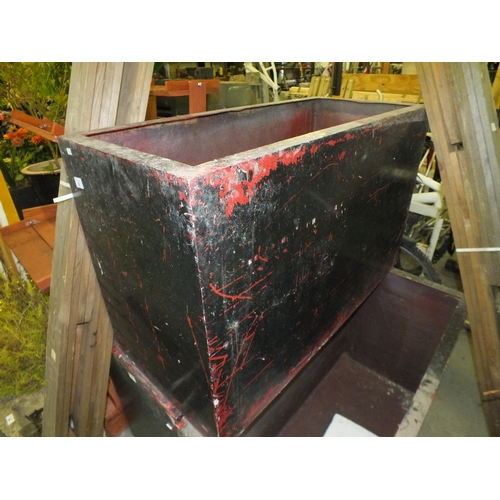 31 - Oblong black planter approx. 4' l  x 3' h x 1' w...