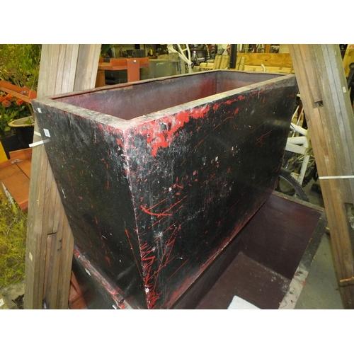 32 - Oblong black planter approx. 4' l  x 3' h x 1' w...