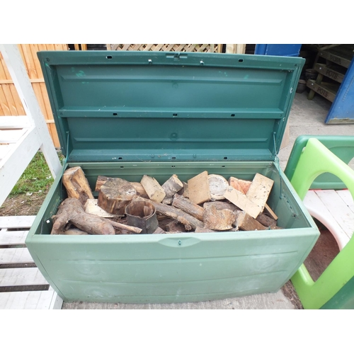 7 - Green garden storage box approx 4 x 3 full of logs...