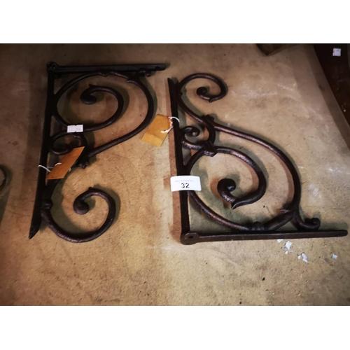 32 - Pair of wrought iron hanging basket brackets...