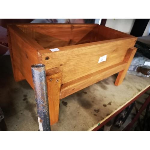 44 - Small raised wooden planter...