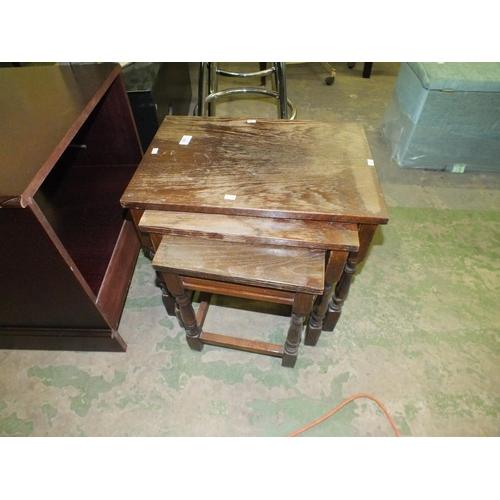 352 - Nest of three dark wood tables...