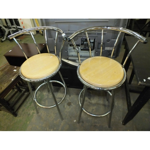 354 - Pair of chrome and beech bar stools...